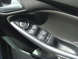 2011 Ford Focus Titanium PwrShift Hatchback.