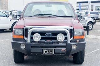 2002 Ford F250 XLT Super Cab Utility.