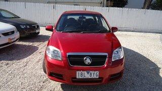 2011 Holden Barina Sedan.