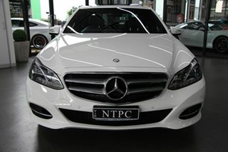 2013 Mercedes-Benz E200 BlueEFFICIENCY 7G-Tronic + Elegance Sedan.