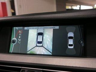 2012 BMW M5 M-DCT Sedan.