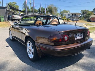 1989 Mazda MX-5 Roadster Coupe.