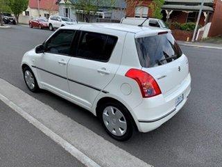 2010 Suzuki Swift Hatchback.