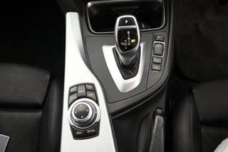 2014 BMW 320i Sedan.