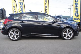 2012 Ford Focus Titanium PwrShift Hatchback.